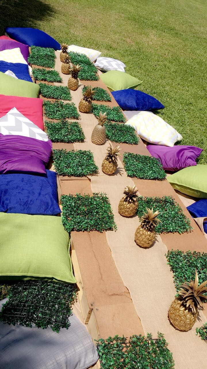 our cushions and pallet tables chilling in the sun at a 21st tropical birthday party