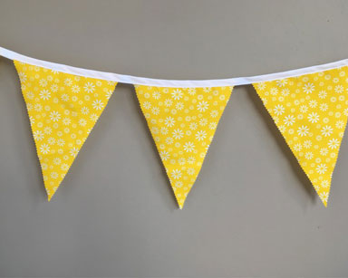 KZN090 &#8211; YELLOW FLORAL BUNTING <br/>(R25 to hire)