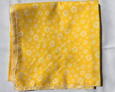 KZN091 &#8211; YELLOW FLORAL TABLE CLOTH <br/>(R35 each to hire)