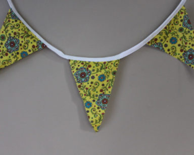 KZN035 &#8211; Yellow and blue floral bunting <br/>(R25 to hire)