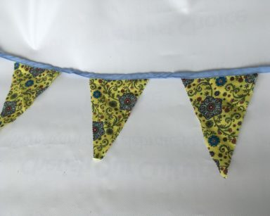KZN051 – BLUE AND YELLOW FLORAL BUNTING (R35 to hire)